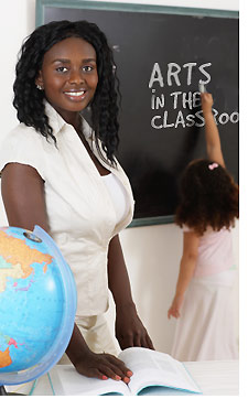 AIC Teacher at Chalkboard